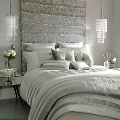 pretty gray bedroom - love the headboard and those gorgeous pendants over the nightstands!