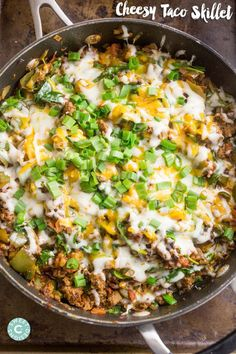 Cheesy Taco Skillet with Lean Ground Turkey, Yellow Onion, Bell Pepper, Diced Tomatoes, Baby Kale, Shredded Cheddar Cheese, Green Onions.