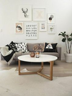 Scandinavian-interior-living-room-white-sofa-chairs-plant