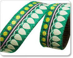 "AMY BUTLER 5/8"" ribbon--Cream on Green Sari Petal--price is per yard by FancifulFabrics on Etsy https://www.etsy.com/listing/168027784/amy-butler-58-ribbon-cream-on-green-sari"