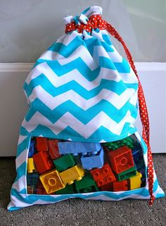 Store small toys in sacks, but sew in peek-a-boo windows so that you know what's inside