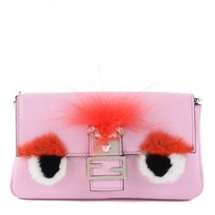 This is a stylish and authentic FENDI Calfskin Rabbit Fox Fur Micro Buggie Baguette in Pink. This micro-sized baguette is delightfully crafted of light pink subtly grained leather.