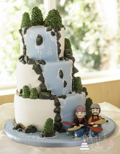 Kayaking wedding cake for a couple who love the outdoors and especially kayaking! Fondant Cakes, Cupcake Cakes, Cupcakes, Kayak Cake, Birch Wedding Cakes, Waterfall Cake, 18th Party Ideas, Sport Cakes, Fancy Cookies