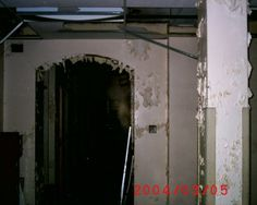 The Haunted North America Team took this photo at Whitby Psychiatric Hospital in Whitby, Ontario - this is the well-known ghost of Kaitlyn peeking around the doorway - she was being channeled by Caraig Mitton
