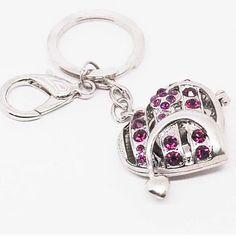 Promotional Heart Design Gift Keychain  Item Code: KY61025  Material: Zinc Alloy, Crystal  Size: 3.5 * 3.5 cm  Cadmium Free + Lead  Free + Nickel free  Accept Engrave Logo on product or print on packing   Packing:1 pc into 1 opp bag ,12 pcs in a big bag + standard export carton