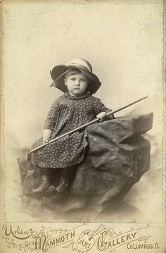 vintage photo of girl with garden rake