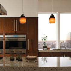 A row of Alina Pendants look great hanging over a kitchen island. http://www.ylighting.com/blog/top-10-tech-lighting/