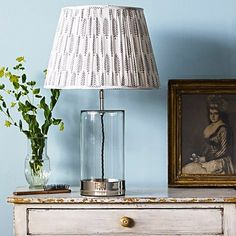 The glass-and-nickel Wisteria Table Lamp from UK lighting company Pooky, comes with dozens of shade options in a range of sizes; this block-printed-cotton Empire Gathered Lampshade starts at Clear Glass Table Lamp, Table Lamp Base, Lamp Bases, A Table, Table Lamps, Table Lamp Shades, Glass Lamps, Patterned Lampshades, Pooky Lighting