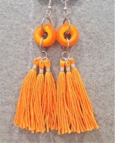 Orange glass bead and tassel earrings by bdenglass on Etsy