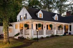 Gorgeous treed setting and lovely front porch.