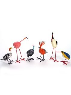"""Seedpod Birds. Using the seedpods of local trees, Zimbabwean artists have created these charming little birds. Standing on hand twisted wire feet, they are between 3-4"""" tall and are handpainted in the rich bright colors of each bird's plumage."""