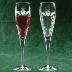 """Galway Crystal Flutes-Pair.    Notable for their radiant clarity, these crystal flutes etched with a claddagh lend themselves to celebratory toasts of all kinds. May be custom-engraved by most jewelers. From Ireland. Boxed. 10"""" tall. $79.99"""