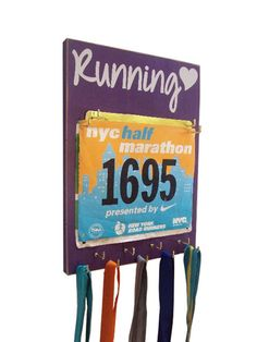 Display your race bibs and medals on this fun wall hanging! Great gift for the serial racer in your life