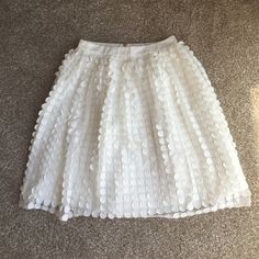 Beautiful cream tulle/polka dot skirt!! This is a gorgeous tulle with polka dot skirt in cream by English Factory!! Has a satin lining. Waist lying flat is 14 inches and length is 23 inches. Never been worn! Small flaw-see last picture I think it is makeup? Other than that it's perfect!  English Factory Skirts A-Line or Full