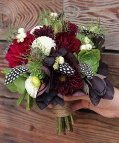 Bold bouquet of dahlias, smokebush, various aeonium and sempervivum rosettes, snowberries, nigella pods, and a few fun guinea hen feathers.