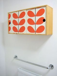 bathroom cabinet - covered with Orla Kiely wallpaper, such a great idea!