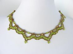 Free beading pattern for lovely antique-looking green crystal necklace.