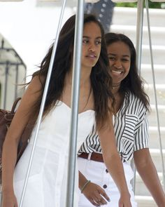 Malia and Sasha Obama were spotted giggling and chatting as they jetted off for their family's two-week vacation to Martha's Vineyard