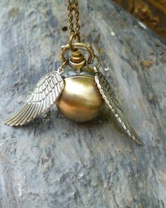 SALE Quiddich golden snitch pocket watch bronze sphere locket on bronze chain Giftboxed Christmas Harry Potter gift Under20. $9.99, via Etsy.