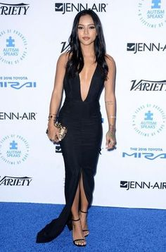 Cutie Karrueche Tran was an absolute stunner in a black deep plunge gown at the Autism Speaks Celerity  event in Los Angeles.