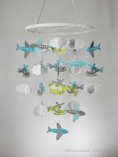 Airplane Helicopter and Cloud Baby Mobile by whimsicalaccents on Etsy. Perfect nursery decor for your little pilot.