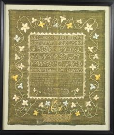 An overall image of a unique ground color embroidery. The embroidery had been stored folded for many decades. It resulted in weakness and tears forming along the vertical center. The embroidery was stabilized, mounted and  framed at Spicer Art Conservation.