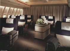 I remember BA First class in the 1990s: 1989 featured heavy draped curtains, purple seating and floral...