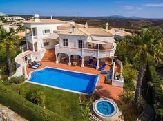 Villa with pool, jacuzzi, golf and ocean views in Budens, Algarve for sale – VReedom