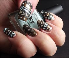 Ithinity Beauty ~ Nail Art Blog. Feather and tribal nail art design.