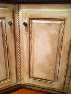 French Linen & Old White with clear and dark wax.  Distressed cabinets.