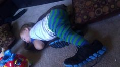 Out like a light... With mama's shoes on!!
