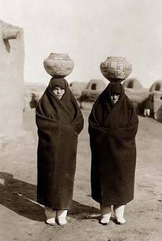 Zuni Water Carriers. It was created in 1903 by Edward S. Curtis.