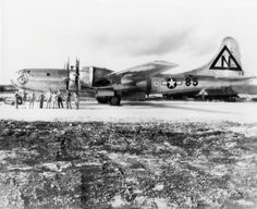 A shiny metal four-engined aircraft stands on a runway. The crew pose in front of it. Nagasaki, Hiroshima, First Atomic Bomb, Enola Gay, Airplane Fighter, Manhattan Project, Army Corps Of Engineers, Military Units, Total War