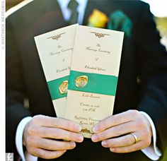 The bride made the tri-fold programs herself and got some help from her mom wrapping them in satin ribbon and sealing them with a wax monogra