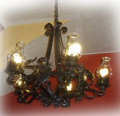 This is produced in various sizes. The chandelier is often used for illuminating high ceiling living rooms, foyer and house entries. Black Iron Chandelier, Iron Chandeliers, Hacienda Homes, Hacienda Style, Hotel Foyer, Ceiling Lamp, Ceiling Lights, High Ceiling Living Room, Wall Sconces