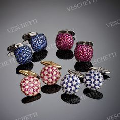 Cufflinks set with diamonds, rubies and sapphires