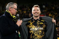 Ronan Keating Photos Photos - Ronan Keating shows off his Hurricanes tshirt during the round 16 Super Rugby match between the Hurricanes and the Chiefs at Westpac Stadium on June 9, 2017 in Wellington, New Zealand. - Super Rugby Rd 16 - Hurricanes v Chiefs