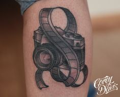 Image from http://www.tattoobite.com/wp-content/uploads/2013/10/black-ink-camera-with-film-tattoo.jpg.