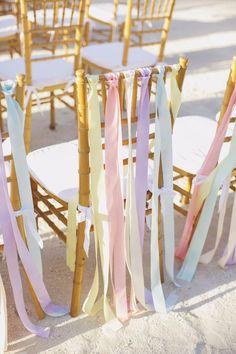 Pastel wedding chair ribbons / http://www.himisspuff.com/ribbon-wedding-ideas/2/