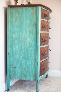 Painted blue dresser,hand painted design on the side and the drawers left natural wood.
