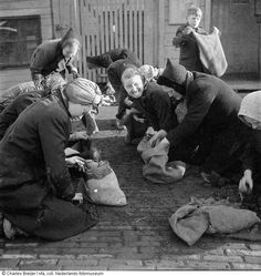 1944 - 1945. Women searching for coal near Het IJ in Amsterdam. During the hongerwinter in Amsterdam there's was no petrol, no electricity and very little food. There were 40,000 malnourished children in the big cities, including Amsterdam, during the hongerwinter. More than 20,000 people lost their lives in Amsterdam and the western part of the Netherlands during the winter of 1944-1945. Photo Nederlands Fotomuseum / Charles Breijer. #amsterdam #worldwar2