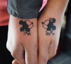 We are in love with these Disney-themed couple tattoos: M and M kiss