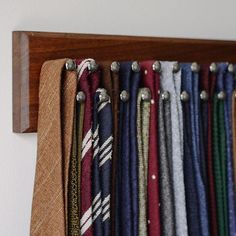 Finally got a chance to get my @dapperwoodworks custom tie rack put up. It couldnt be a more perfect timing to show you guys. They are currently celebrating hitting 500 followers and offering 20% off with the code DAPPER (valid until Friday). Head over to their site and check out all the stock and custom items available. . Tie rack full of some new and old favorites from @vecchioanseatico @rculturi @drakesdiary @bergandberg Conrad Wu @tieyourtie @sozzicalze via @nomanwalksalone…