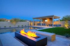 Would love to have this pergola and fireplace in our backyard.