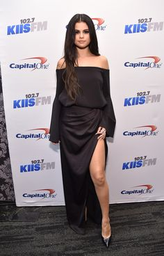 Selena Gomez dresses up in an off-the-shoulder Camilla and Marc gown for the Jingle Ball 2015.