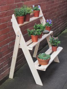 """20 Awesome Cascading Planter Decor Ideas And Remodel to Change your Garden. Explore Roomadness's board """"cascading planter"""" Wooden Plant Stands, Diy Plant Stand, Garden Shelves, Plant Shelves, House Plants Decor, Plant Decor, Garden Projects, Wood Projects, Regal Display"""