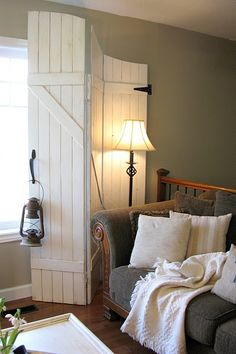 Cover a plain bi-fold door with barn door look for closets, storage or, like here, window treatment. or as a headboard, distress it and hang a wreath on it.
