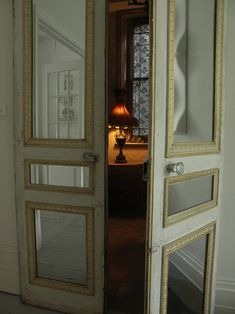 older doors, picture framing or molding and mirrors...and there you have it for a great DIY. pic via a perfect grey...