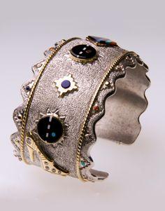 "Bracelet   Jesse Monongye (Navajo, Hopi). ""Terrace Cloud""  18k gold, six diamonds, Acoma Jett, dolomite, lapis, Sleeping Beauty turquoise"