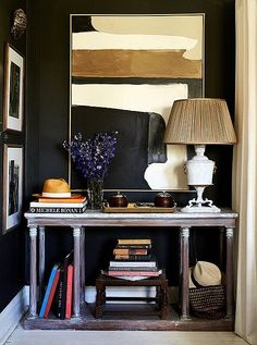 "William applied lime wax to the console to soften the color and give it an aged look. The lamp was left over from a showhouse he did in New Orleans, so he whitewashed it and added a new shade. ""That's the power of an expensive shade,"" he says."